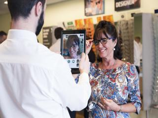 Optician measure your glasses frame with iPads